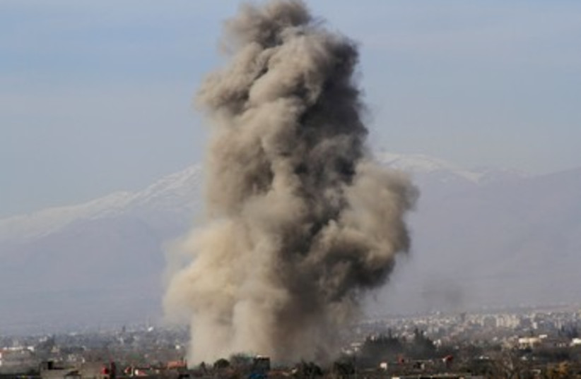Smoke after alleged Barrel-bomb explosion in Syria, January 31, 2014 (photo credit: REUTERS)