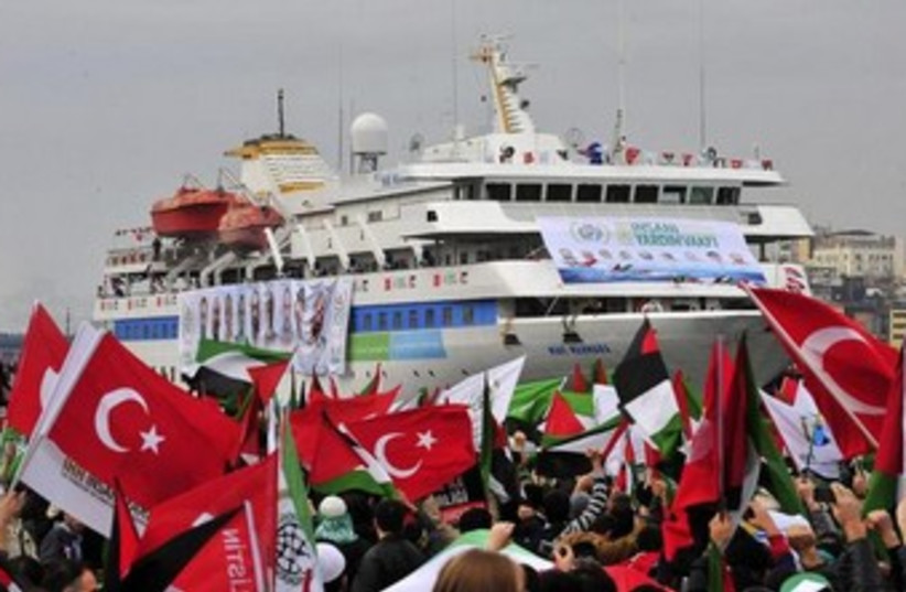 Pro-Palestinian activists wave Turkish and Palestinian flags during the welcoming ceremony for cruise liner Mavi Marmara at the Sarayburnu port of Istanbul December 26, 2010. (photo credit: REUTERS)