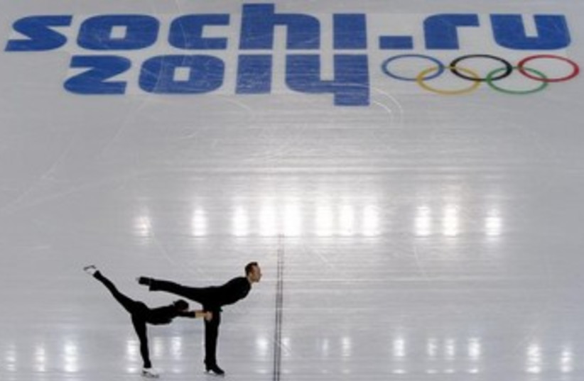 A couple skates at a pairs figure skating training session at the Iceberg Skating Palace, in preparation for the 2014 Sochi Winter Olympics February 4, 2014. (photo credit: REUTERS)