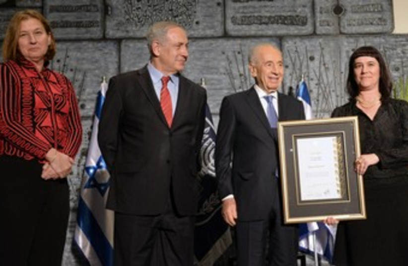 PM Binyamin Netanyahu, President Shimon Peres and Tzipi Livni fight against human trafficking.  (photo credit: Mark Neiman/GPO)