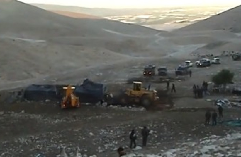 Civil Administration bulldozers destroy a tent in the Palestinian village of Khirbet 'Ein Karzaliyah in the Jordan Valley on January 8. Photo  (photo credit: COURTESY OF B'TSELEM)