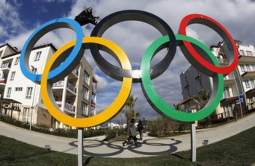 Olympic rings in the Coastal Athlete's Village in Sochi, February 4, 2014 (photo credit: REUTERS)