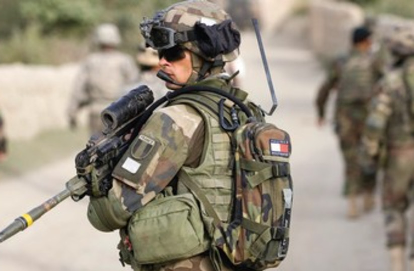 A FRENCH soldier of the NATO-led coalition patrols in the mountains of Wardak Province in Afghanistan in 2009. (photo credit: REUTERS)