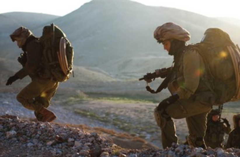 SOLDIERS FROM the Nahal Reconnaisance Battalion take part in exercices concluding an eight-month advanced training course. (photo credit: COURTESY IDF SPOKESMAN'S OFFICE)