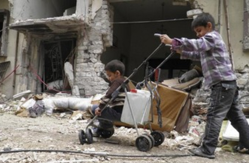 Besieged area of the Syrian city of Homs. (photo credit: REUTERS)