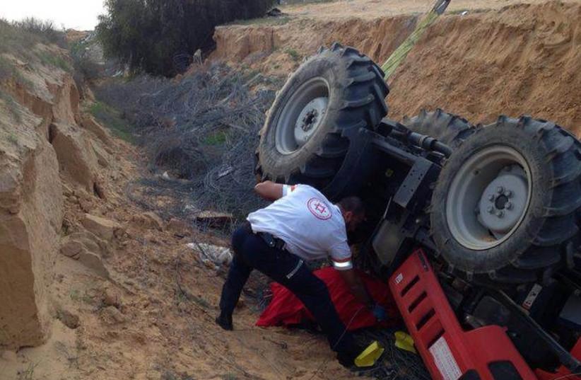 Tractor accident, February 7, 2014 (photo credit: MAGEN DAVID ADOM)