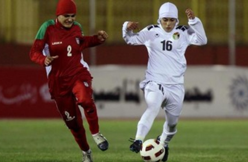 A soccer player from Iran's women's team at a qualifying match for the 2012 London Olympics. (photo credit: REUTERS)