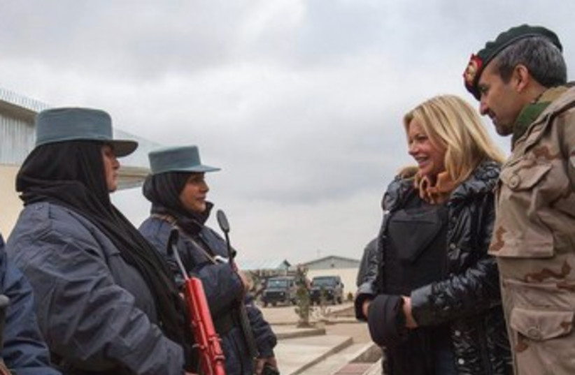 Dutch Defense Minister Jeanine Hennis-Plasschaert visits Afghan soldiers (photo credit: REUTERS)