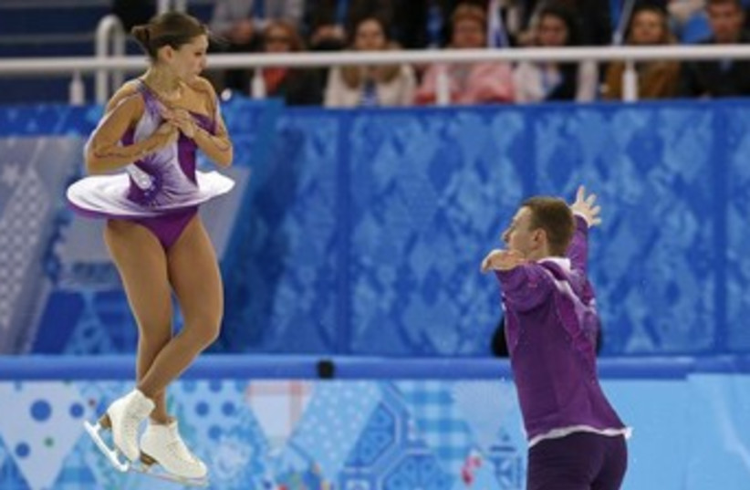 Andrea Davidovich (L) and Evgeni Krasnopolski finish their figure skating pairs short program at the Sochi 2014 Winter Olympics, February 11, 2014.  (photo credit: REUTERS)