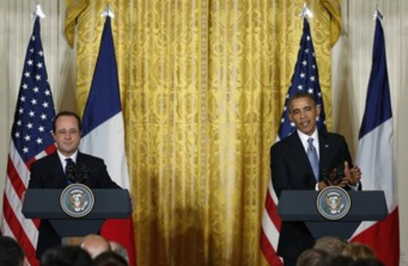 US President Barack Obama and French President Francois Hollande address a joint news conference in Washington, February 11, 2014. (photo credit: REUTERS)