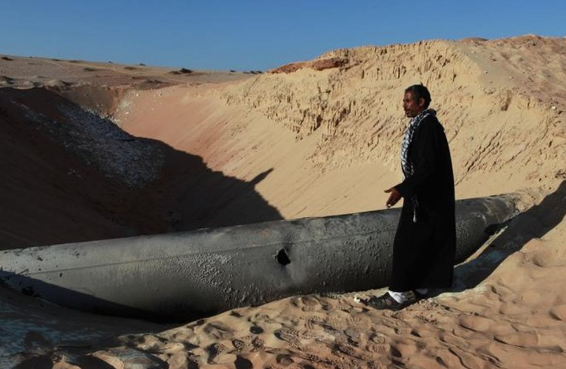 Egyptian gas pipeline carrying gas to Israel and Jordan hit by a RPG, March 6, 2012. (photo credit: REUTERS)