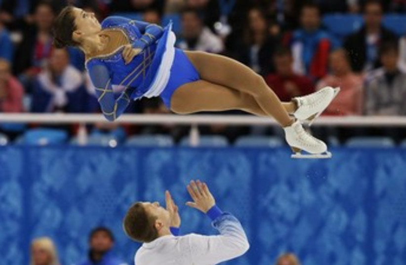 Andrea Davidovich (top) flies through the air after being tossed by partner Evgeni Krasnopolski. (photo credit: REUTERS)