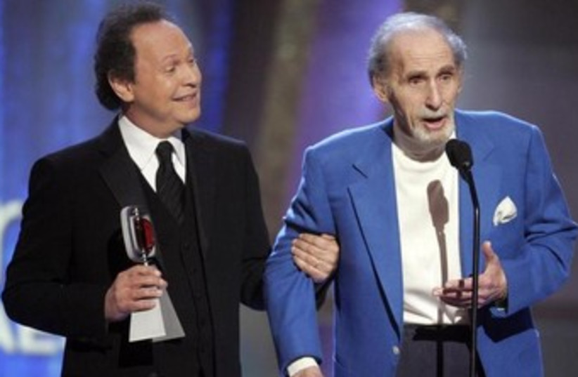 Comedians Sid Caesar (R) and Billy Crystal (photo credit: REUTERS)
