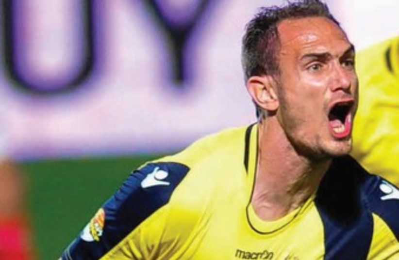 After failing to score a single goal for Maccabi Tel Aviv in his first 38 Premier League matches for the club since the start of 2012/13, defender Carlos Garcia has found the back of the net in each of his past two appearances. (photo credit: ASAF KLIGER)