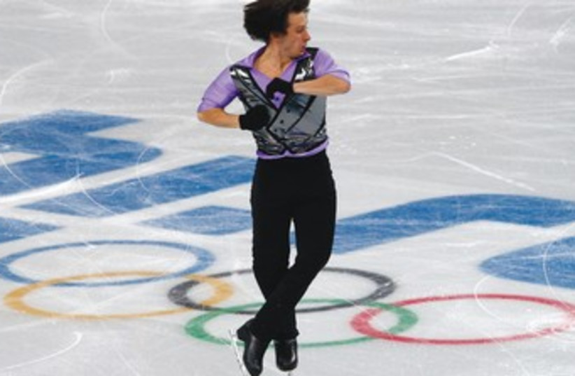 Israel's Alexei Bychenko will take part in the figure skating men's free program on Friday after finishing the short program in 22nd place at the Sochi Olympics on Thursday. (photo credit: REUTERS)