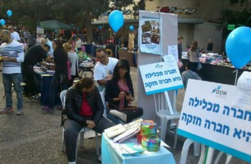 "Intellectually disabled people give shiatsu massages to passersby in Ramat Gan last week as part of ""Akim in the Square"" informational campaign (photo credit: COURTESY OF AKIM)"