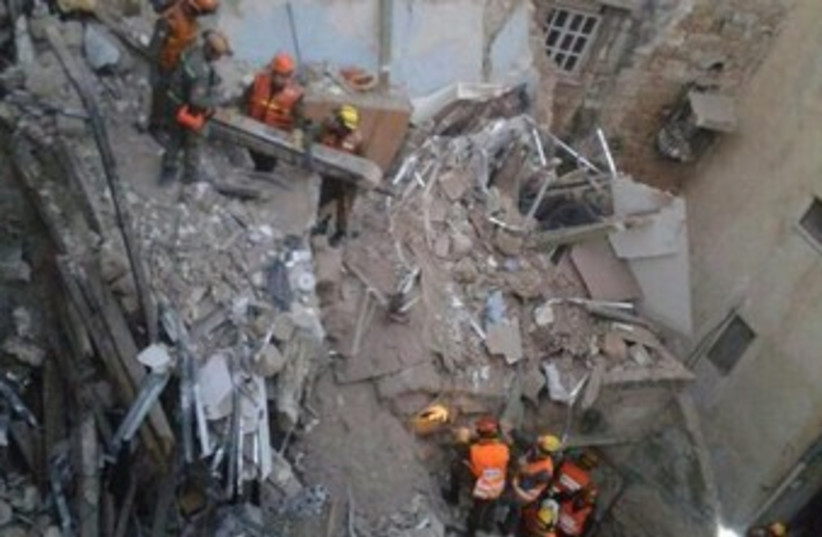 Building collapse rubble in Acre (photo credit: IDF)