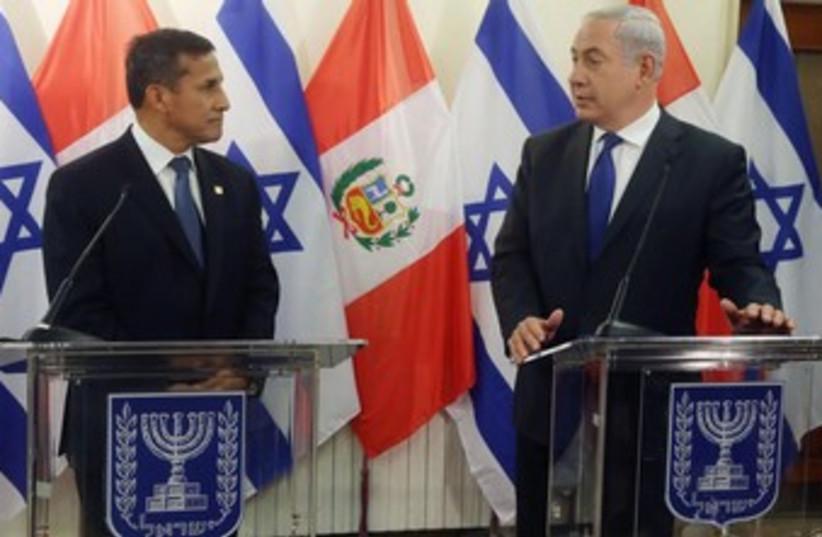 Prime Minister Binyamin Netanyahu meets with Peruvian President Ollanta Humala, February 17, 2014 (photo credit: MARC ISRAEL SELLEM/THE JERUSALEM POST)