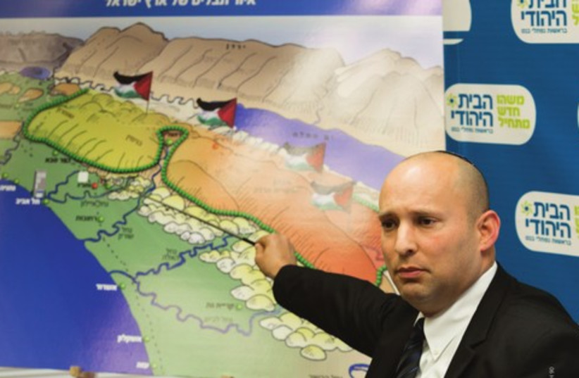 Bayit Yehudi party leader Naftali Bennett points to a map of the Palestinian state looming over the State of Israel (photo credit: FLASH 90)