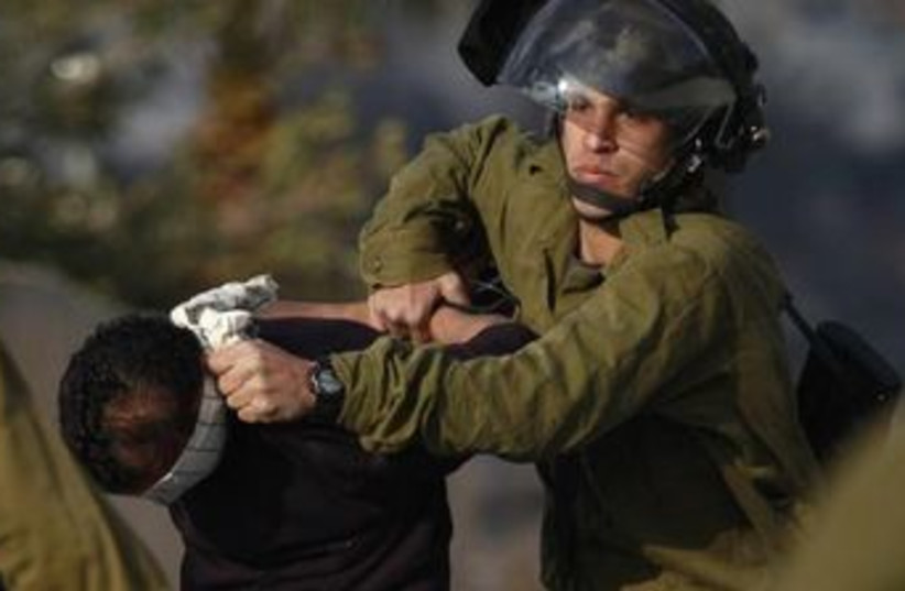 IDF soldiers arrest Palestinian suspect in West Bank (photo credit: REUTERS)