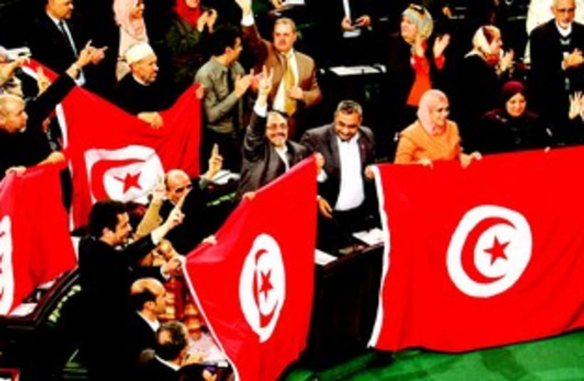 Parlement tunisien lors de l'adoption de la Constitution (photo credit: REUTERS)