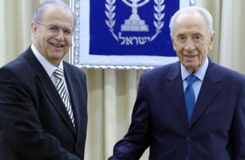 President Shimon Peres with Cypriot FM Ioannis Kasoulide. (photo credit: Mark Neiman/GPO)
