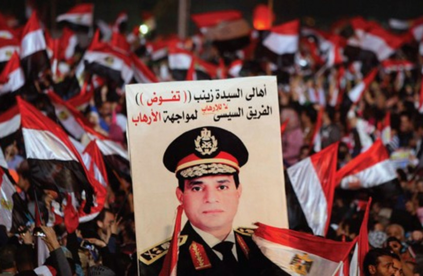 Supporters of Abdel Fatah al-Sisi in Tahrir square in Cairo, on the third anniversary of Egypt's uprising, January 25 (photo credit: REUTERS)