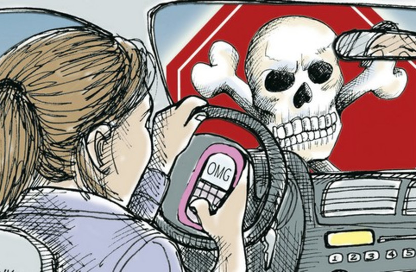THE DANGER of texting and driving is well publicized; what is less known is that even when walking and using a smartphone, one can become oblivious to their surroundings. (photo credit: MCT)