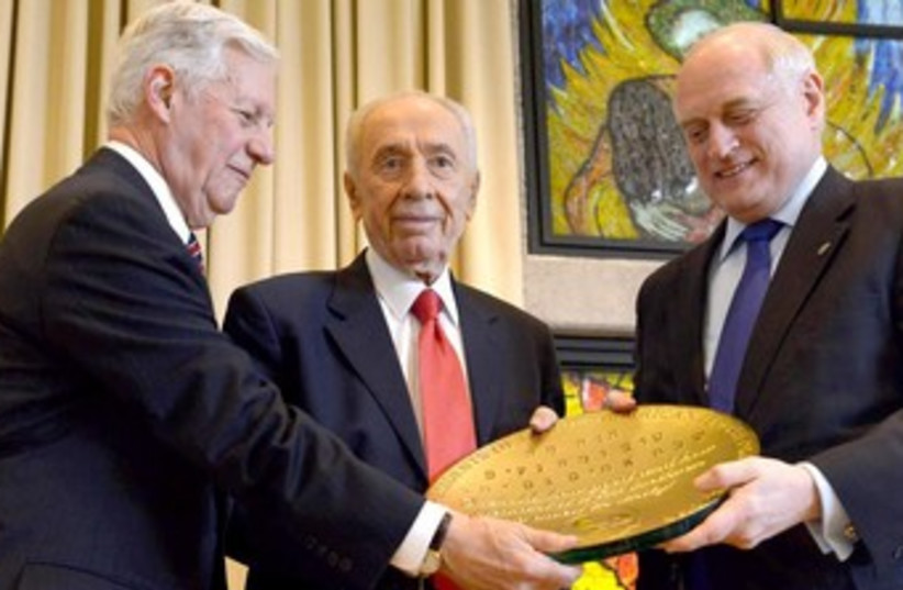 President Shimon Peres recieves award from Presidents Conference  (photo credit: Mark Neiman/GPO)