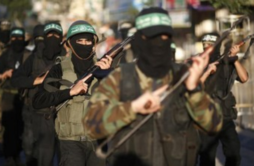 Palestinian members of Hamas's al-Qassam brigades. (photo credit: REUTERS)