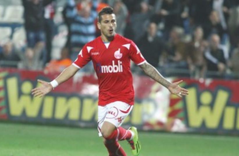 Hapoel Beersheba midfielder Maor Buzaglo celebrates after scoring one of his two goals in Saturday's 4-0 victory at Hapoel Ramat Hasharon. (photo credit: ADI AVISHAI)