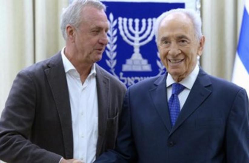 President Shimon Peres welcomes Johan Cruyff to the President's Residence. (photo credit: Mark Neiman/GPO)