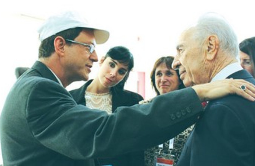 Peres listens to Yosef Abramowitz as wife Susan and her sister comedian Sarah Silverman look on. (photo credit: Courtesy)