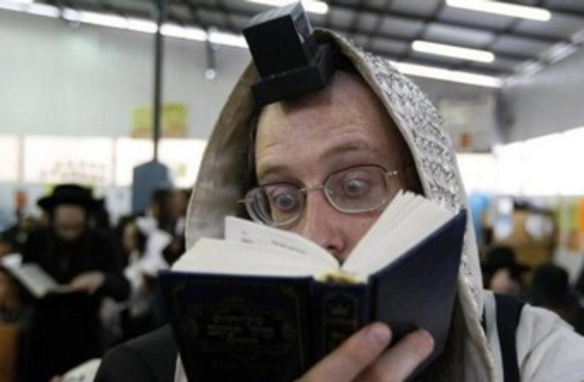 An Orthodox Jew prays in the Ukrainian town of Uman. (photo credit: REUTERS)