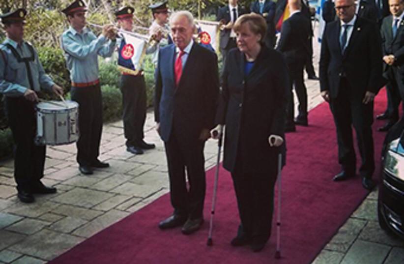 President Peres and German Chancellor Merkel (photo credit: GPO)