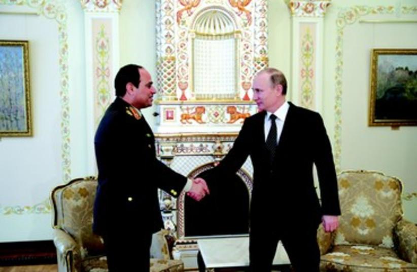 Vladimir Poutine et le maréchal Al Sissi (photo credit: REUTERS)