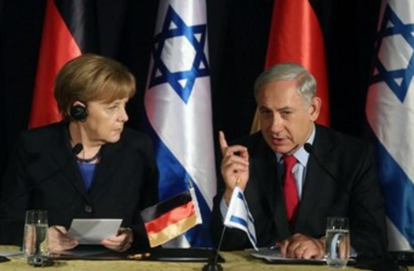 Prime Minister Binyamin Netanyahu and German Chancellor Angela Merkel in Jerusalem, February 25, 2014. (photo credit: MARC ISRAEL SELLEM)