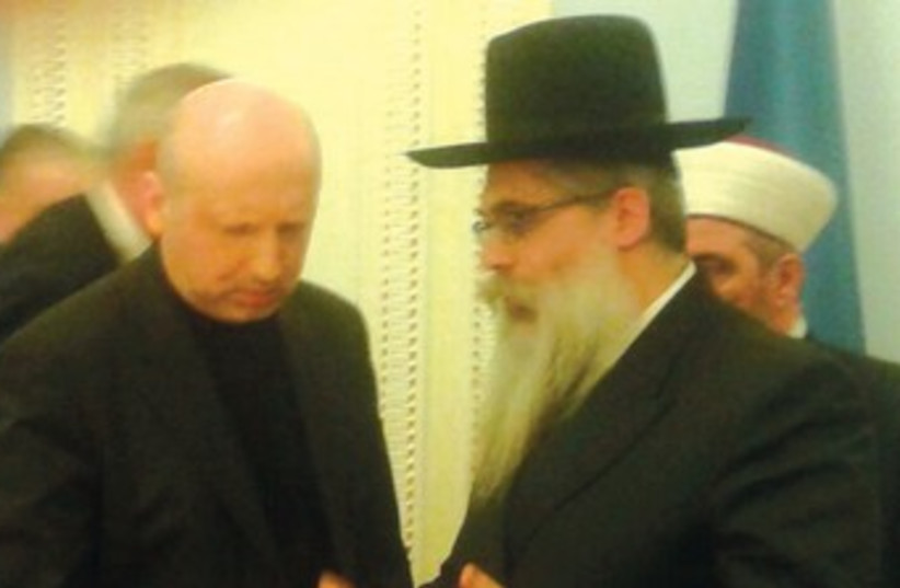 Ukrainian Chief Rabbi Dov Bleich speaks with interim President Oleksander Turchinov on Tuesday. (photo credit: CONFERENCE OF EUROPEAN RABBIS)