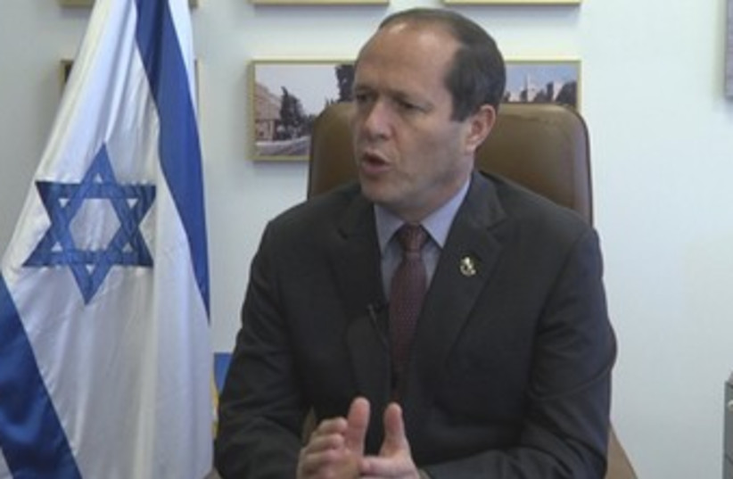 Nir Barkat in his office  (photo credit: ELI MANDELBAUM)