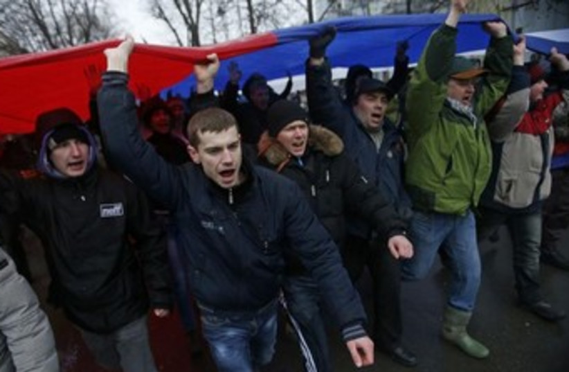 Pro-Russian supporters in Ukraine attend a rally in the Crimea. (photo credit: REUTERS)