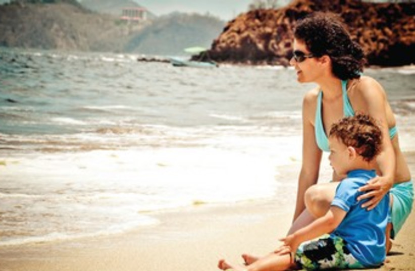 THE AUTHOR'S wife and son at Playa Conchal on the country's Pacific coast. (photo credit: DARREN PINSKER)