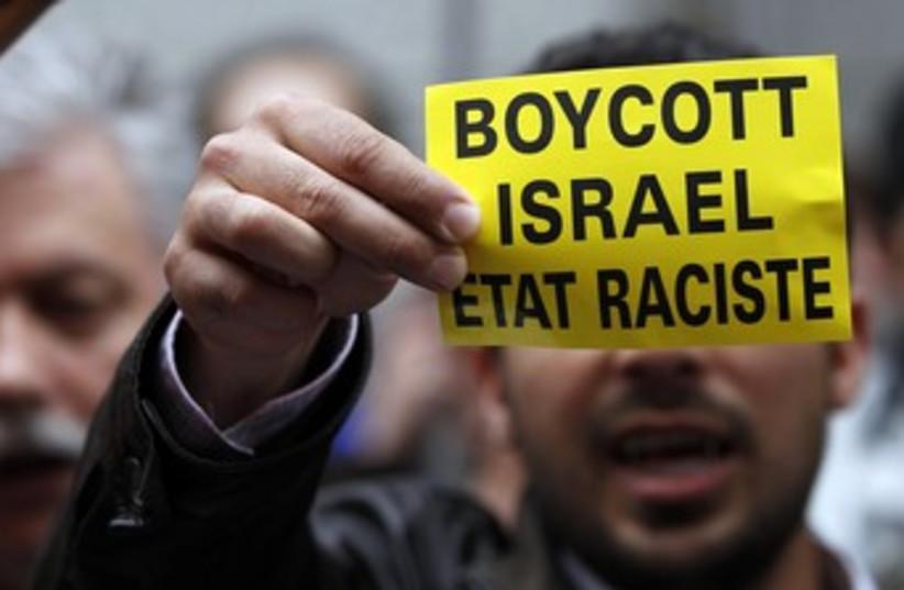 Man holds boycott Israel sign (photo credit: REUTERS/FRANCOIS LENOIR)