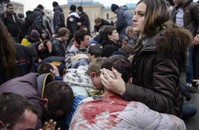 Wounded supporters of pro-government forces in Ukraine recover from riots. (photo credit: REUTERS)