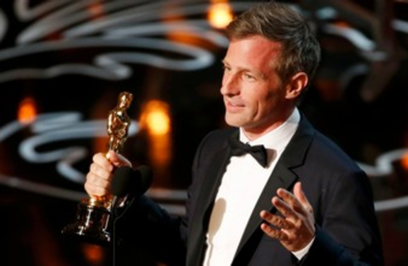 """Spike Jonze, winner original screenplay for """"Her"""", speaks on stage at the 86th Academy Awards in Hollywood, California March 2, 2014. (photo credit: REUTERS)"""