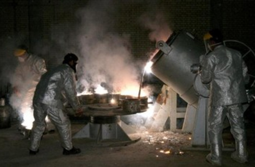 Iranian technicians work at a uranium processing site in Isfahan. (photo credit: REUTERS)