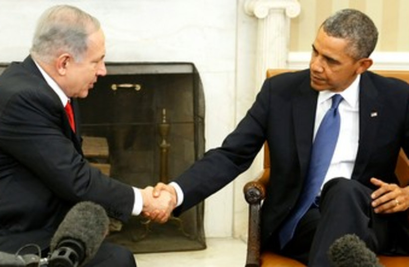 Netanyahu and Obama shake hands at start of Oval Office meeting, March 3, 2013 (photo credit: REUTERS)