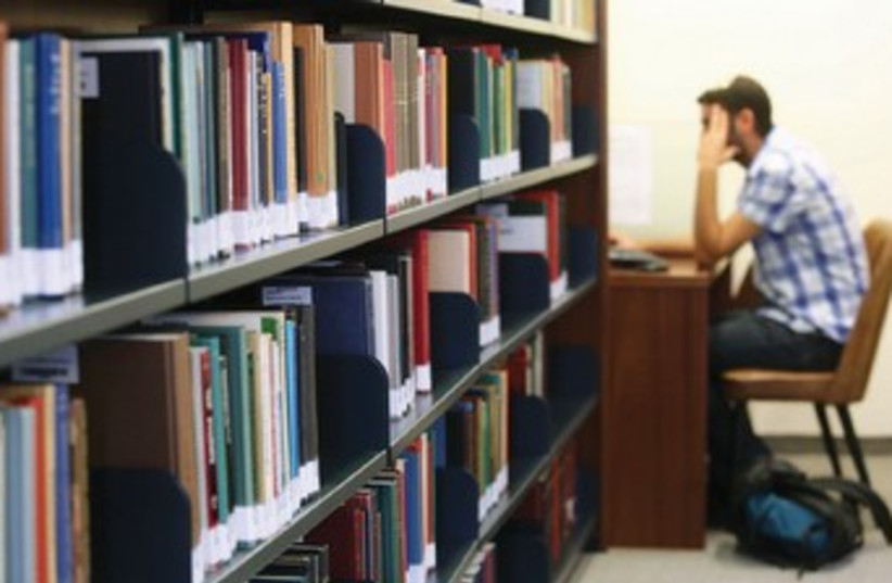 A man studies in a university library. (photo credit: MARC ISRAEL SELLEM)