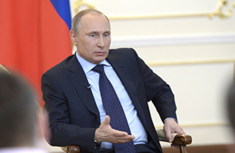 Russian President Vladimir Putin, March 4 2014 (photo credit: REUTERS)