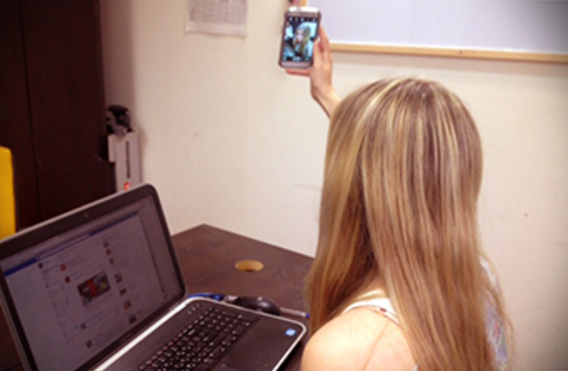 Girl taking selfie (photo credit: JPOST STAFF)