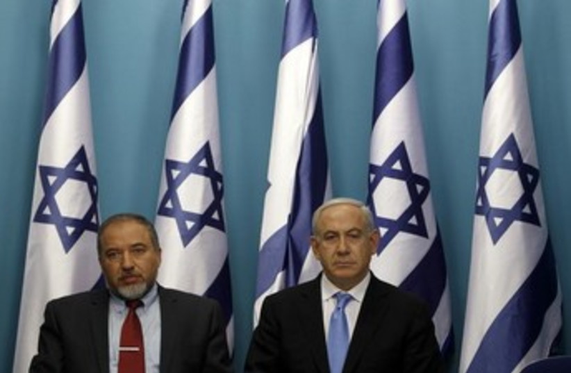 Foreign Minister Avigdor Liberman (L) and Prime Minister Binyamin Netanyahu (R), (photo credit: REUTERS)